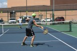 Junior Joseph Naville volleys the ball at tennis practice on Wednesday, Aug. 12.