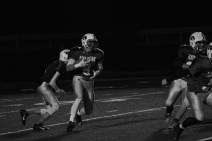 Sophomore Brandon Striegel runs the ball up the middle.