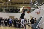 Senior Aidan Flanigan does a reverse dunk, winning the final round of the dunk contest.