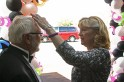 Retiring principal Janie Whaley fixes husband Roger Whaley's hair. Photo by Shelby Pennington.