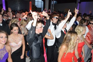 """Prom participants dance to the """"Cha-Cha Slide."""" Photo by Sarah Strain."""