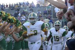 Seniors Donovan Hickman and Tyler Young lead the Highlanders out of the locker room and into the student tunnel. Photo by Braden Schroeder