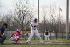 Senior Jon Cato bats at the plate.