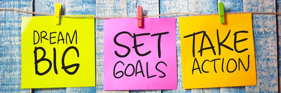 Sticky notes saying Dream Big, Set Goals, Take Action