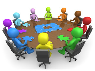 stick figure people around a meeting table