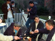 SOME AMONG THE RUSSIAN BUSINESSMEN'S delegation visiting the Washington, D.C., area are shown here enjoying a leisurely barbecue at a private home in Falls Church last Saturday night. (News-Press photo)