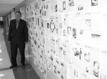 IN THE HALL in front of his English classroom, years of front pages of the George Mason High School newspaper, The Lasso, that Michael Hoover advised have been displayed this spring. Hoover completed a 37-year classroom teaching career at the school by addressing his commencement ceremony last Thursday. (News-Press photo)