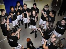 SPORTING THEIR BLACK 'Family' shirts, the Mason High girls pump themselves up before taking on Middlesex High last Saturday. (Photo: Rich Johnson)