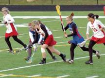 FRESHMAN ABBY JOHANSEN scoops up a ground ball for the Mustangs in their 18-5 win over Park View. (Photo: Courtesy Jane Johansen)