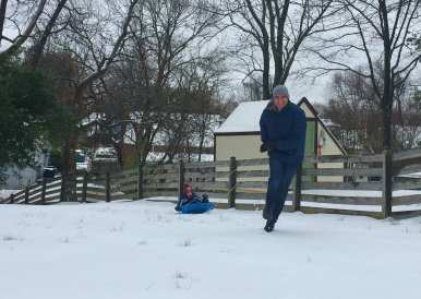 """Mason, in the sled, gets a pull from Joey """"Substitute Reindeer"""" Cavada in Falls Church. (Photo: Lexi Cavada)"""