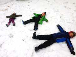 Falls Church kids, ages 3, 6 and 9, making snow angels. (Photo: Rosaly Kozbelt)
