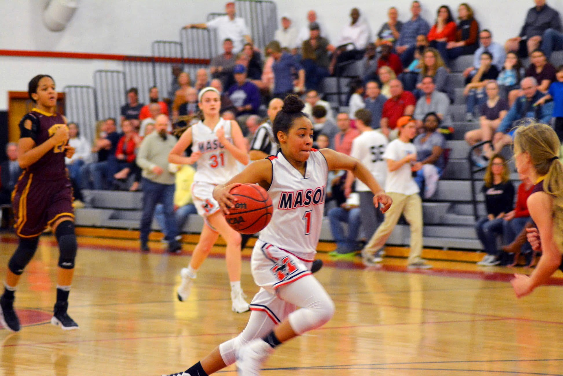 Mason'd Nicole Bloomgarden drives to the basket in the Mustang's home semifinal loss to Nottoway High School last Thursday. (Photo: Carol Sly)