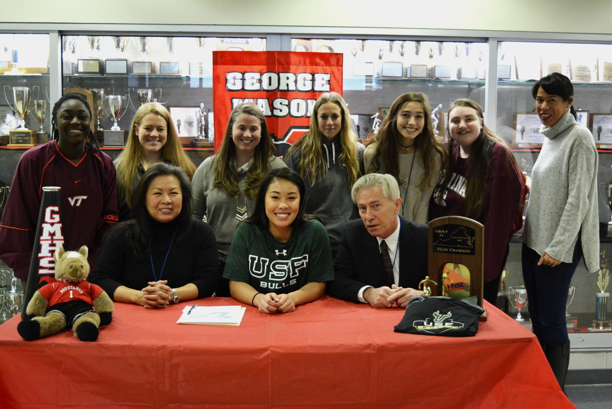Becca Crouch (center) with friends and family after signing letter of intent to play soccer at the University of South Florida. (Photo: Carol Sly)