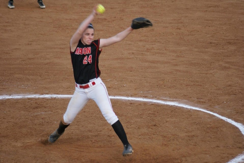 MASON SENIOR PITCHER JULIA FERRIS winds up a pitch during one of the Mustangs games in 2015. Although she pitched a game worthy of a win, the Mustangs were handed their first loss of the season on Friday, April 1 against Warren County High School. The Mustangs lost 5-1 to the Wildcats. (Photo: Carol Sly)