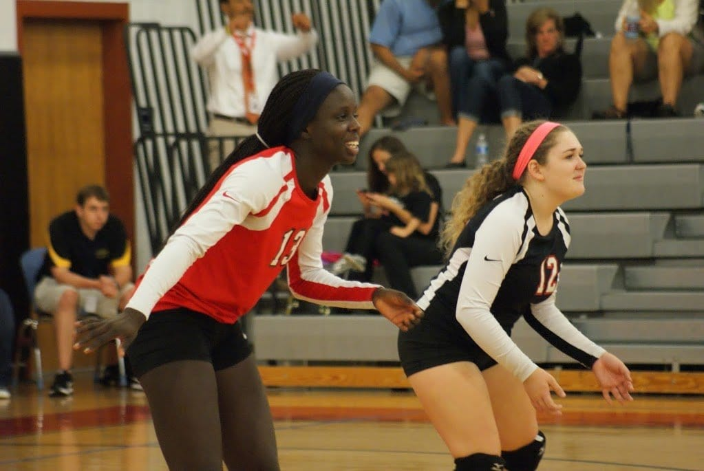 MASON'S VICKY-MARIE ADDO-ASHONG and Mary Catherine Donovan get ready to receive a serve in a match earlier this season. The Mustangs defeated Clarke County 3-1 this week. (Photo: Courtesy of Carol Sly/FCCPS Photo)