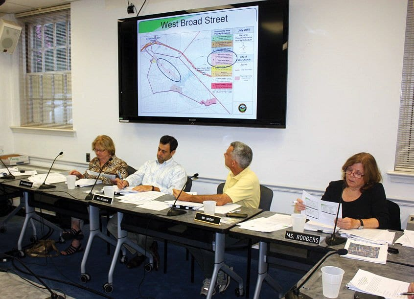 """FALLS CHURCH SENIOR PLANNER Paul Stoddard (far left) spelled out parts of the """"small area plan"""" that has been devised for the middle section of W. Broad St. to members of the Planning Commission Monday night. (Photo: News-Press)"""