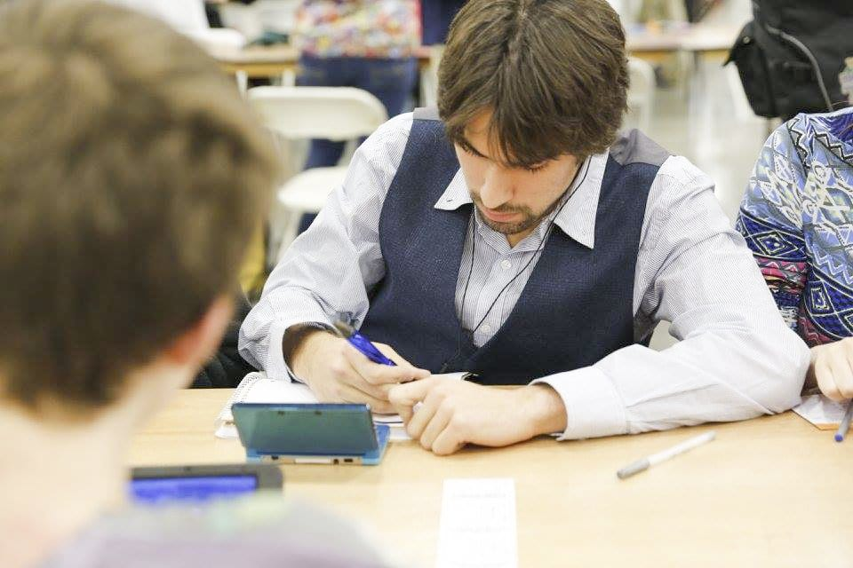GLICK TAKES NOTES during a match at the 2015 Pokemon Winter Regional Championships. He's been entering Pokemon competitions since 2011, when he was a freshman at McLean High School, and has won the Pokemon National Championships twice. (Photo: Courtesy of Doug Moriosoli)