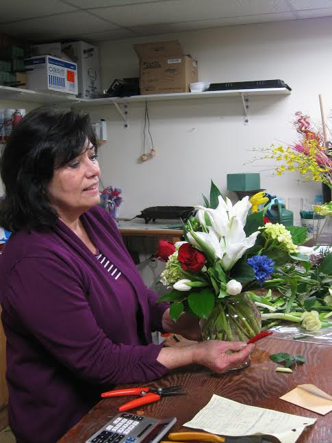 Carol Beales, the owner of Galleria Florist, shows off bi-colored roses. She said that the days leading up to Valentine's Day and the day itself are the busiest days of the year for her business. (Photo: Patricia Leslie/News-Press)