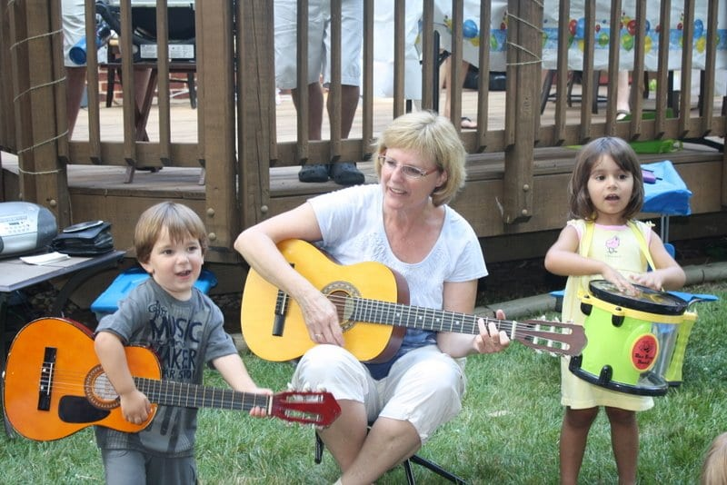 Maddy O'Neill-Dean makes music with two young performers. She teaches Music Together classes, instructing children from birth to 5 years in singing, dancing, and playing instruments. (Courtesy Photo)
