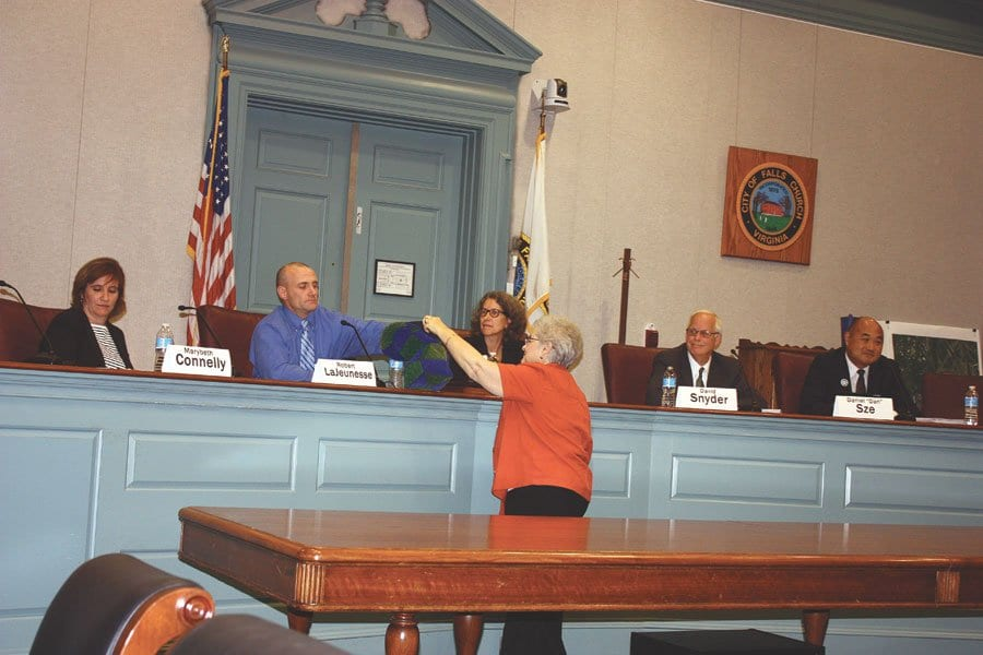 MODERATOR MARJORIE HOBART passed a big hat for candidates for the Falls Church City Council to draw questions from at last week's debate in the F.C. Council chambers. Candidates shown here are (l. to r.) Marybeth Connelly, Bob LaJeunesse, Karen Oliver, David Snyder and Dan Sze. (Photo: News-Press)