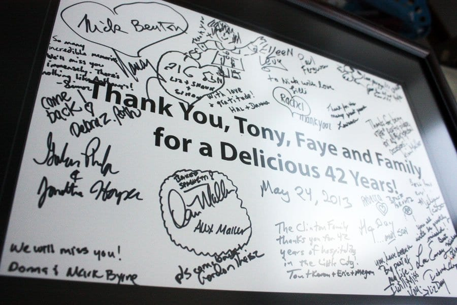 A tribute signed by all in attendance at an Anthony's farewell party presented to Anthony and Faye. (News-Press photo)