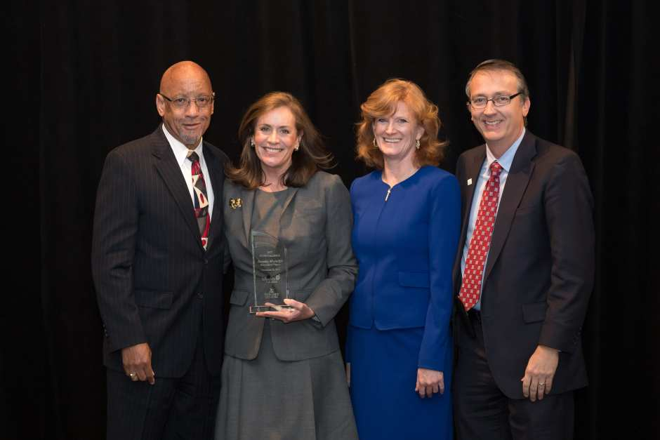 Group photo of First Lady Dorothy McAuliffe and FCPS staff posting with the FCPS Champion Award