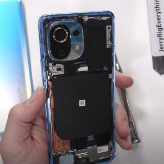 Mi 11 with back removed and green-tinted scew (credit: JerryRigEverything)