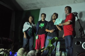 James Castillo (second from right) hands out certificates of participation to youth attending Permaculture workshop