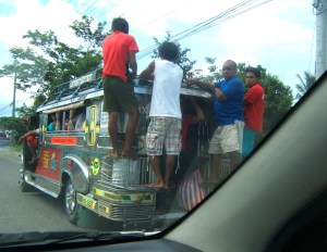 Overflowing jeepney in Tacloban City, Leyte, Philippines (August 2014)