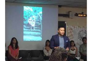 Marc Butiong hosting the REPORT BACK after the trip to the Philippines at DePaul University August 2015