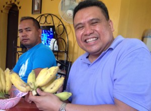 Dale Asis (right) showing off a different variety of bananas he has not tried (March 2016)
