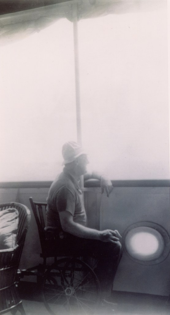 FDR sits in wheelchair aboard yacht, looks out to sea. April 1935.