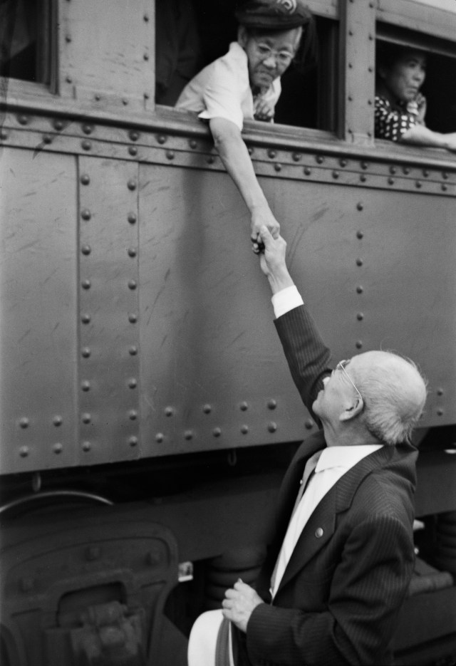 Mrs. Hido Kanow, the mother of four sons serving in the army, bids farewell to a friend as her train departs from the Rohwer Relocation Center in Arkansas for the West Coast. Unidentified photographer July 26, 1945