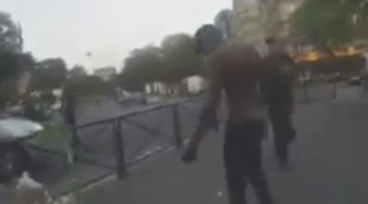 Paris man bursts into flames. Photo taken from the video.