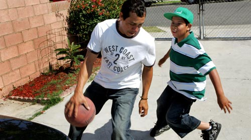 Carlos Alvorado and Son (Photo L.A. Times)
