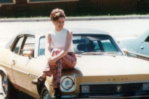 My Mom and her prized possession: her first car.