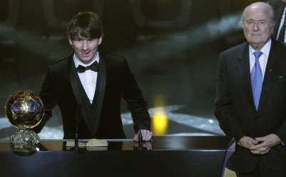 Messi of Argentina FIFA World Player 2010 stands next to FIFA President Blatter during FIFA Ballon d'Or 2010 soccer awards ceremony in Zurich