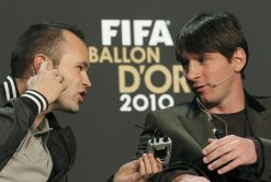FIFA Men's Ballon d'Or of the Year 2010 nominees Iniesta talks to Messi during news conference before the FIFA Ballon d'Or Gala in Zurich