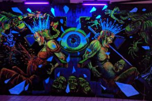 A mural in the queue line area at Fear Overload haunted house in San Francisco.