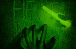 A hand holding a glow stick representing the glow stick fright nights event at Fear Overload.