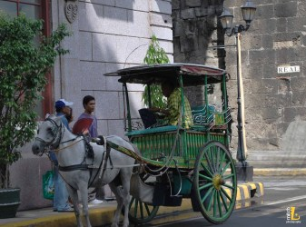 Calesas along the walls, common way to explore Intramuros