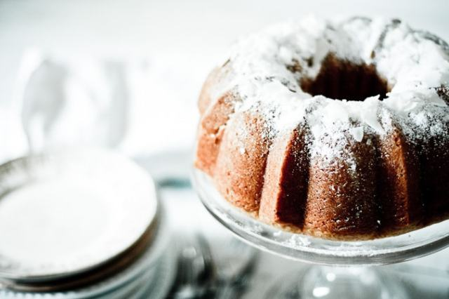 An EASY recipe for the most delicious VEGAN Lemon Coconut Bundt Cake...use meyer lemons for extra goodness. One bowl, simple!