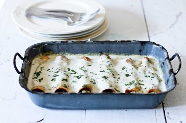 Roasted Poblano Enchiladas with Chicken or Cauliflower - with a delicious velvety poblano cream sauce. Serve with fresh cilantro and lime. | www.feastingathome.com