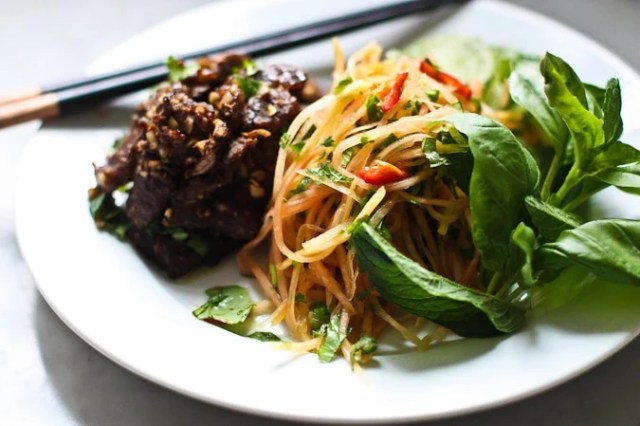 A simple delicious recipe for Vietnamese Beef with Green Papaya Salad- full for flavor this recipe is one of my favorites! | www.feastingathome.com