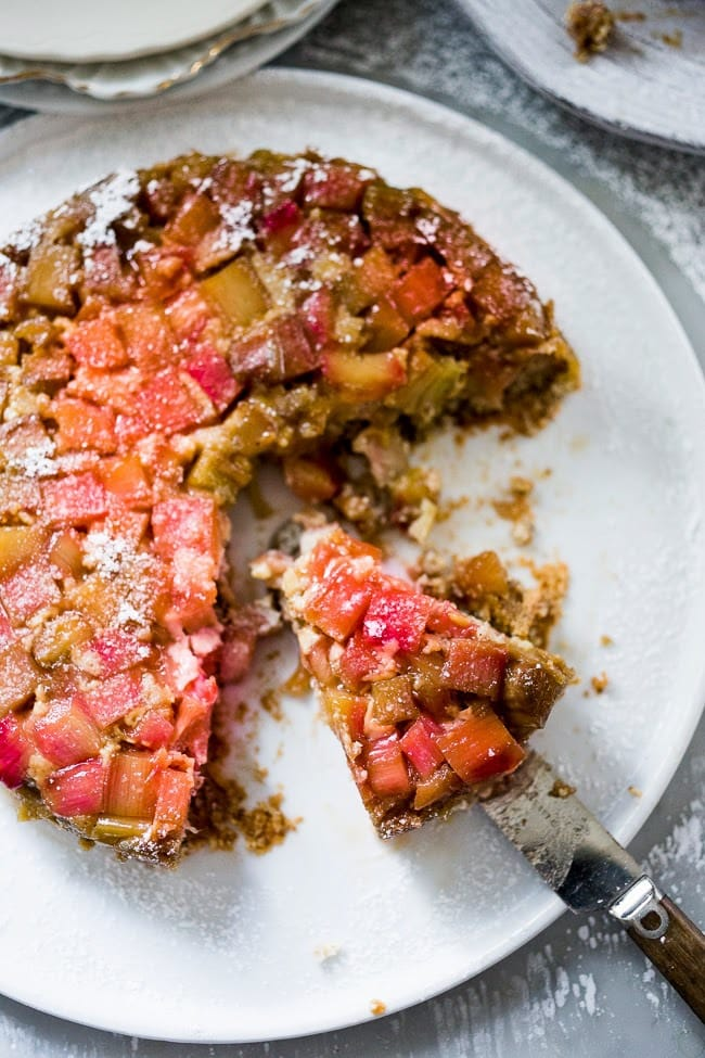 GF Upside Down Rhubarb Cake made with Almond Flour. Deliciously addictive, perfect for Spring. | www.feastingathome.com
