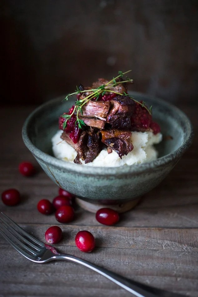 A simple and delicious recipe for Cranberry Pot roast ...served with horse radish mashed potatoes. | www.feastingathome @feastingathome
