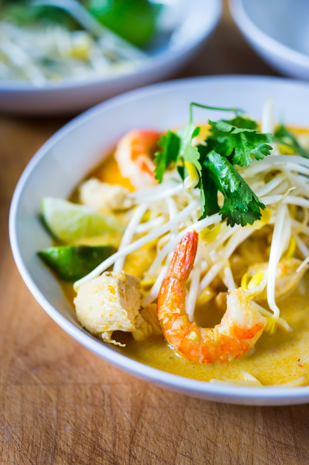 Laksa Soup w/ Malaysian style coconut curry broth, chicken or shrimp over rice noodles with fresh bean spouts, lime and cilantro. | www.feastingathome.com