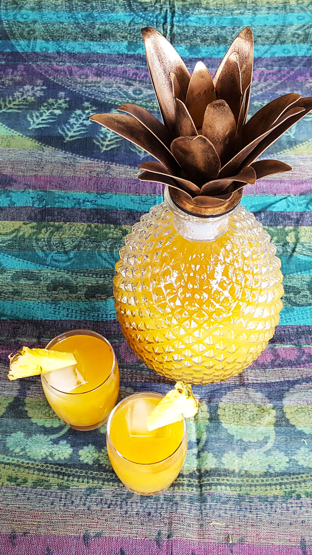 A refreshing mix of pineapple, coconut rum, and a dash of bitters, Rendezvous Rum Punch is the perfect large batch cocktail for your own Caribbean Fete!