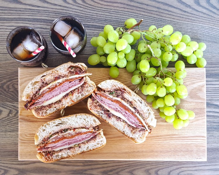 Pressed Muffuletta Sandwich for a Crowd & Tips for a Brilliant Beach Picnic | Feast In Thyme