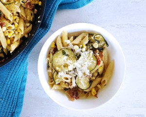 Full of seasonal flavors, this Creamy Corn & Zucchini Summer Skillet Pasta is an easy crowd-pleasing meal perfect for any weeknight, coming together in 45 minutes or less!   FeastInThyme.com